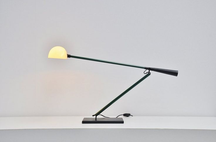 Very nice and multifunctional desk or table lamp by Paolo Rizzatto for Arteluce. This is model number 613 not ton confuse with model 612 that doesnt have a base. This lamp has a weighted base and contra weight at the end of the arm, fully adjustable arm and shade. The joint allows the arm to move both on the vertical and on the horizontal plane. Super functional lamp for several lighting uses.