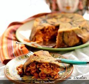 Poche, pochissime parole per uno dei piatti più amati della mia amata isola, il timballo siciliano per eccellenza: quello di anelletti. Al forno ovviamente, ricoperto da melanzane fritte, che forma…