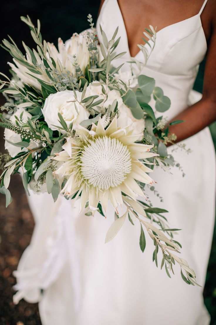 Beautiful Chic Wedding In A Greenery And White Color Palette Focal Flower In This Bridal Bouquet I Protea Wedding Wedding Flower Trends Green Wedding Bouquet
