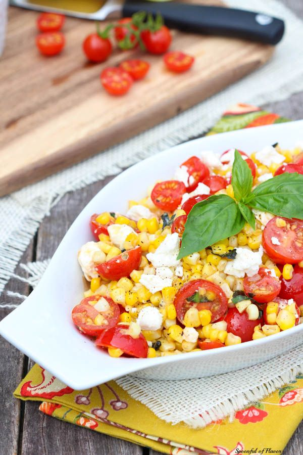 Sauteed Corn with Basil and Tomatoes...The perfect summer barbeque side dish, this recipe includes sweet corn, salty feta cheese and ripe organic cherry tomatoes fresh from the garden