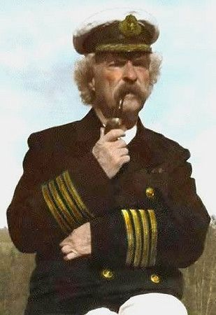 Mark Twain,the great man himself smoking his favourite Peterson pipe.From the Jim Lilley collection.
