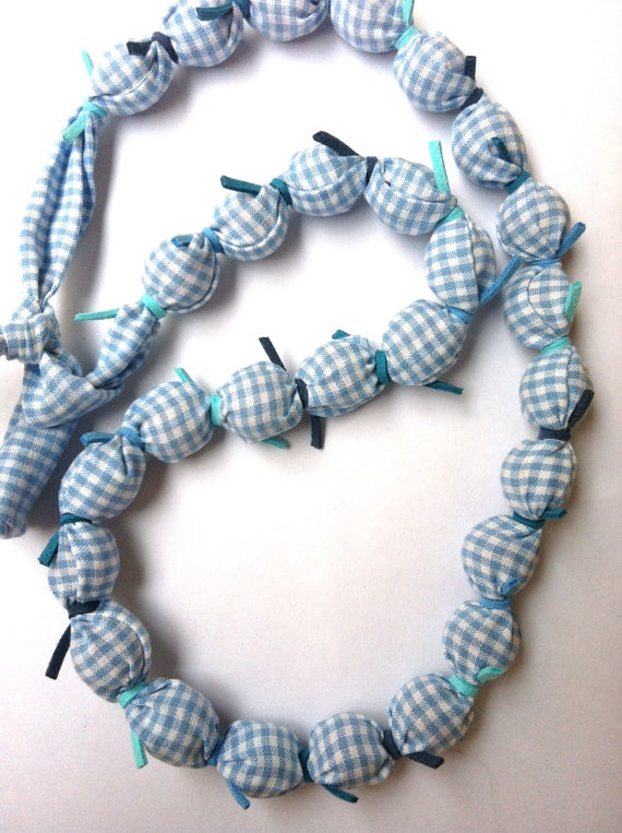Fabric Necklace in light blue and blue colors (made to order). $32.00, via Etsy.
