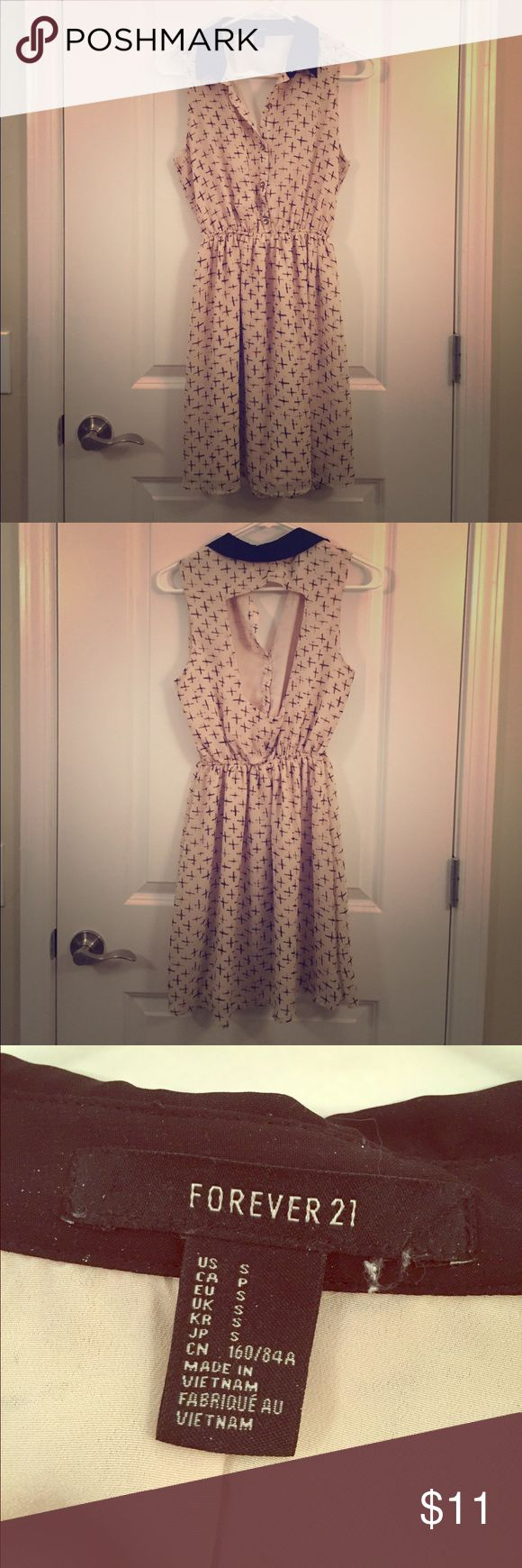 """Forever 21 dress. Nude color w/ black """"x""""s and black collar. 100% polyester. Buttons down in front chest, large cut out in back, waist band stretches. Great dress for going out for dinner! Forever 21 Dresses"""