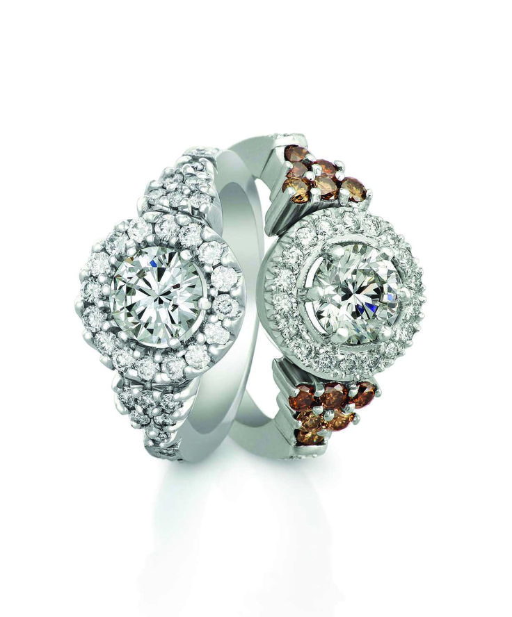 Brilliant cut diamond engagement rings with white and cognac small diamonds in the detail
