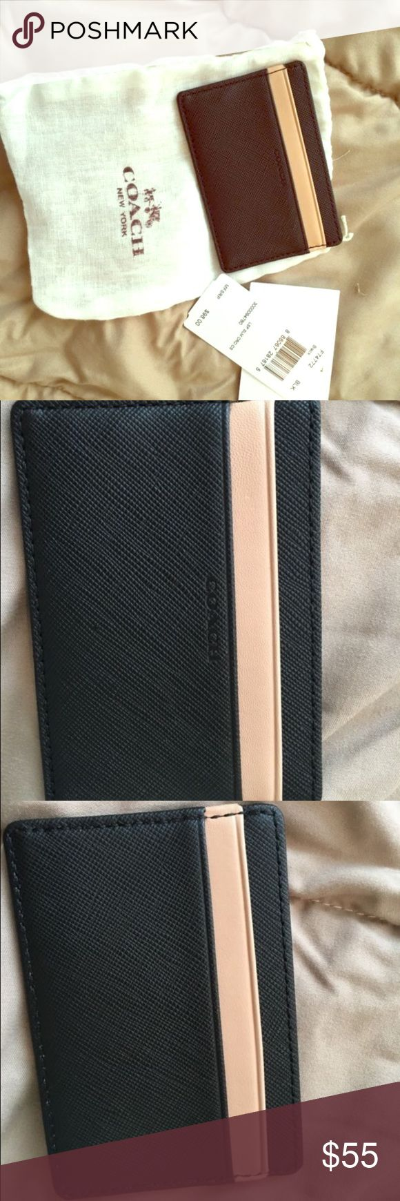 Brand new coach leather skinny wallet Never used comes with tag and original dust bag. Black and Tan leather skinny wallet, perfect for clutches and nights out Coach Bags Wallets
