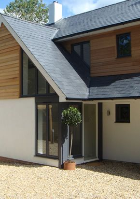 aluminium windows overhanging slate roof render and weatherboard: