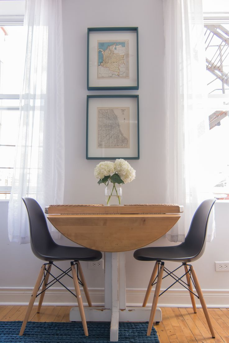 The perfectly sized dining table was a Craigslist find that Jaime painted and distressed.