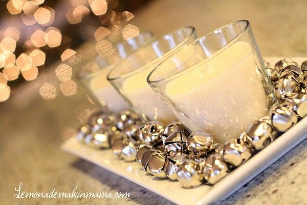 Jingle bells loose on the tables mixed with other ornaments and pine cones we can spray paint silver? i have a ton of mercury tea light tumblers