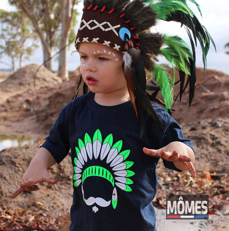 "NEW | We are so so excited to finally introduce you to our most anticipated new design!!  Please meet ""Tonto""- The quirky Indian Chief!! ❤️ We took a long time to finally show him to you due to technical issues but now the short sleeve tees are finally available in our shop in 3 colours! The long sleeve tees and the baby onesies will also be available later today!  Tell us what you think?!!?  Also, we are SO in love with this picture of our little model, petit Nate in his new #MÔMES ""Tonto"