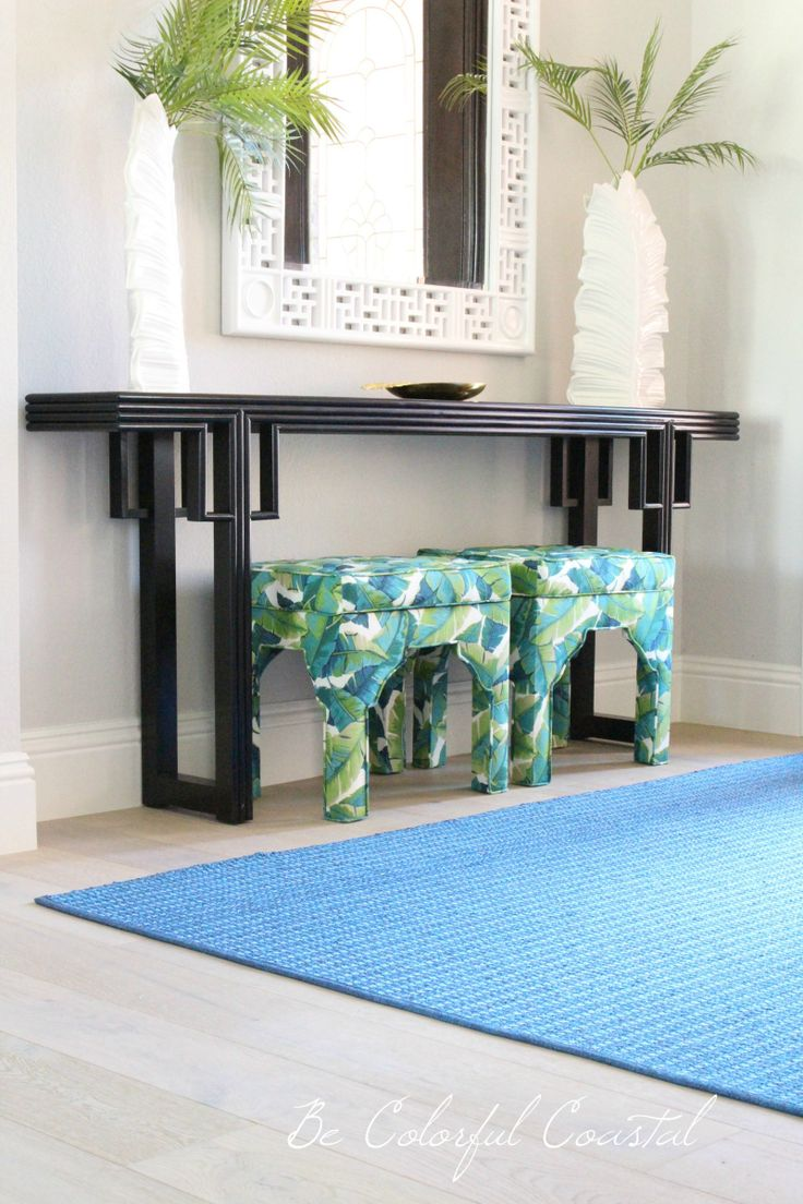 blue and green tropical print upholstered benches, blue sisal rug, tropical entry @ Be Colorful Coastal