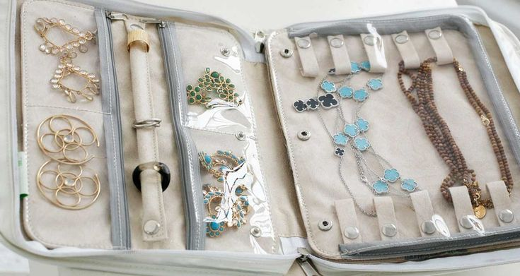 Signature Travel Jewelry Case - $50 - includes ring holder, special tangle-free necklace storage and several pockets.