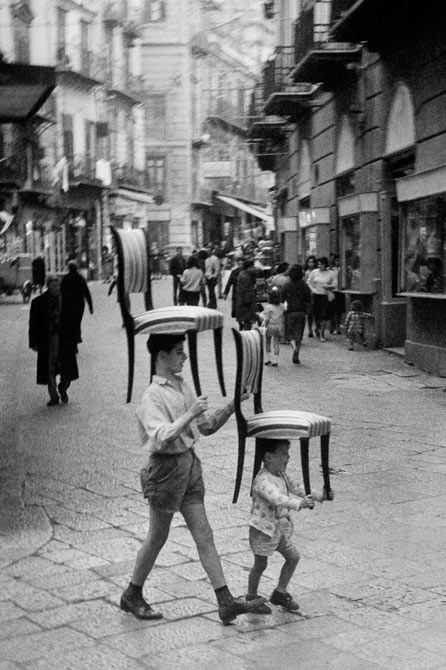 Italy. Carrying chairs, Palermo, Sicily 1960 // photographed by Enzo Sellerio