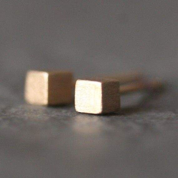 tiny cube stud earrings in 14k gold. If I ever get my ears pierced I will want these.