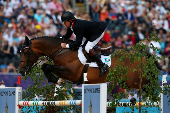 Big Star & Nick Skelton of Great Britain competes in the 1st Qualifier of Individual Jumping on Day 8 of the London 2012 Olympic Games at Greenwich Park on August 4, 2012 in London, England. - Olympics Day 8 - Equestrian