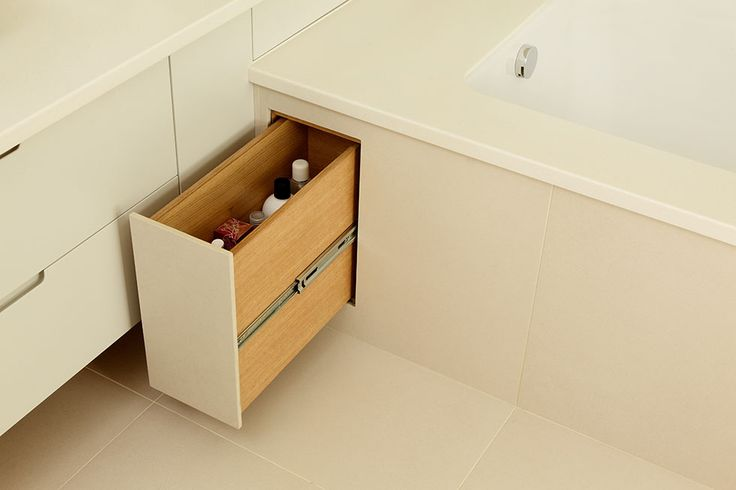 Space-saving in the bathroom is trickier than in the kitchen, so it's best to focus on making the most of what you already have, such as using the void under a standard bath, which can be turned into a small storage cupboard for cleaning products.