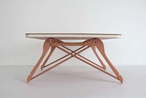 mini table made with wooden coat hangers...cute for a plant stand, etc, in a laundry room.