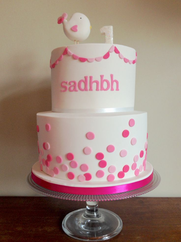 My youngest daughter, Sadhbh's, first birthday cake. Bottom layer is chocolate biscuit cake & top layer is lemon sponge with raspberry jam & vanilla buttercream. All covered in white chocolate ganache & fondant with fondant decorations.