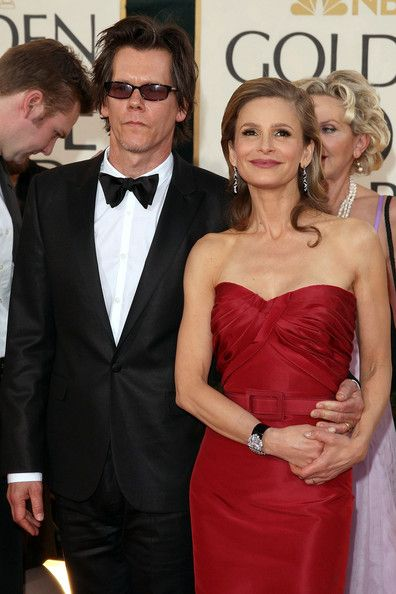 Actors Kevin Bacon and Kyra Sedgwick -married since 1988 and he believes not only in commitment but that she's the hottest babe there is! And yes this makes me love him more!! He also has a band with his brother! <3