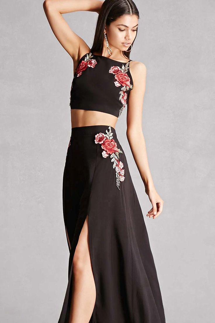 This woven two-piece set with floral appliques by Reverse™ features a crop top with adjustable cami straps and a self-tie back, as well as a semi-sheer maxi skirt with a concealed side zipper, an elasticized back waistband, and a M-slit.