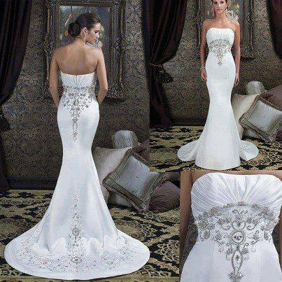 Form fitting wedding dress with long train