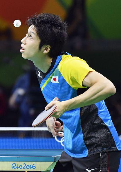 Japan's Jun Mizutani plays against China's Xu Xin during the men's table tennis…