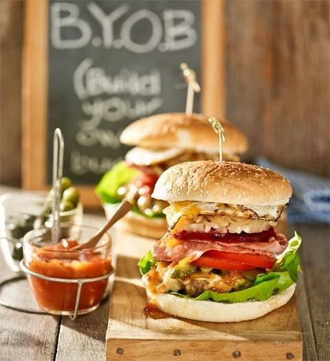 'What's BYOB?', you ask? Build your own burger! Set fillings out for guests to pick their faves. We recommend one with the lot – bacon, gherkins, beetroot, egg, cheese and more – it's the daddy of all burgers!