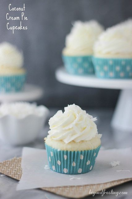 These Coconut Cream Pie Cupcakes are the perfect combination of coconut cake with a lightly sweetened coconut mousse and topped with a cream cheese whipped cream.
