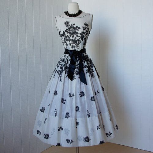 This with white gloves, black heels, and pearls.