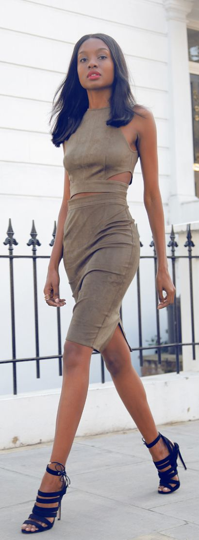 Natasha Ndlovu is wearing suede top and skirt from Missguided and the shoes are from TopShop