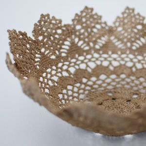 Starch an old doily, wrap it around a bowl...Voila!  lace bowl Add color great for Mother's Day.