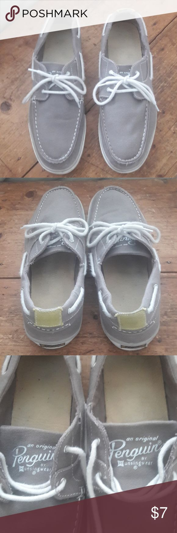Penguin canvas boat shoes These are men's canvas boat shoes. They are in good condition. There is a spot on the back bottom of the left shoes that shows some ware. No holes. Penguin Shoes Boat Shoes