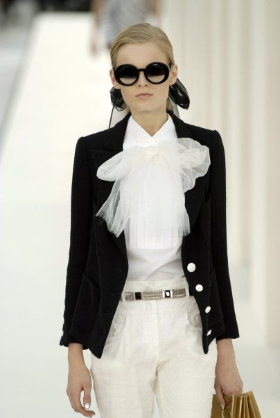 CHANEL. I'm wondering if I can re-create this look by adding a long, white, clear scarf to just a plain white button-up shirt. I LOVE the look of Chanel-not the price. So, I try to re-invent the look on my budget.