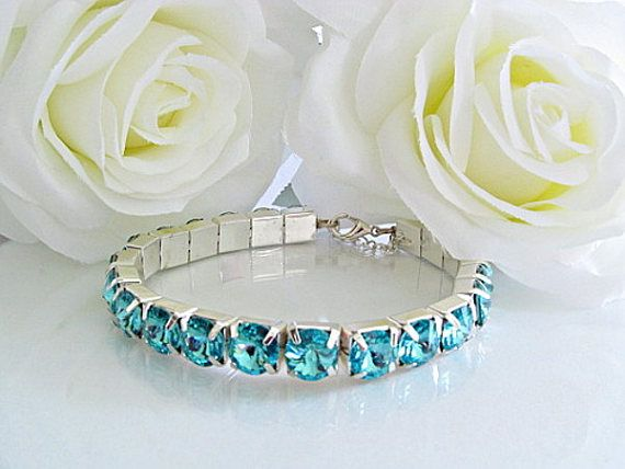 $52  Stunning bracelet with sparkling Swarovski Turquoise crystals. Feel radiant and beautiful when you wear this bracelet with any outfit to give it a gorgeous pop of color!  www.rachelflamdesign.etsy.com