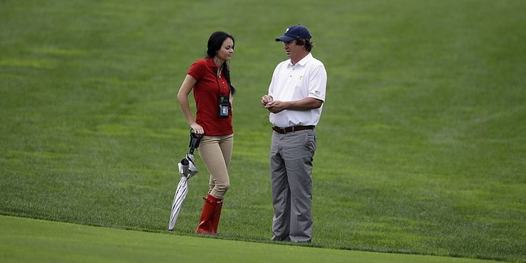 Jason Dufner and his wife Amanda are pictured during the 2013 Presidents Cup. Amanda Dufner filed a divorce settlement on March 16.