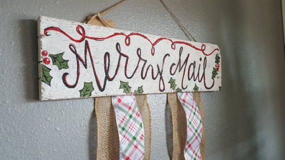 This sweet Christmas card holder is made out of reclaimed wood, painted, and sanded to a distressed Chistmas-y perfection. Merry Mail and the holly berries are hand-painted on a piece of wood and burlap and plaid Christmas ribbon are attached to clip your Christmas cards to.  The wooden sign is 6 inches tall and 21 inches long and the ribbon is 38 inches long.  Hangers are attached on the back.  Each one of our signs and arrows are unique because they are made from 100% reclaimed wood. Each…