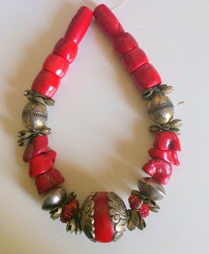 Chunky red coral, nepal huge focal bead, ethiopian silver dome beads, copper bells and turkoman silver and copper beads https://www.etsy.com/shop/FanmMon