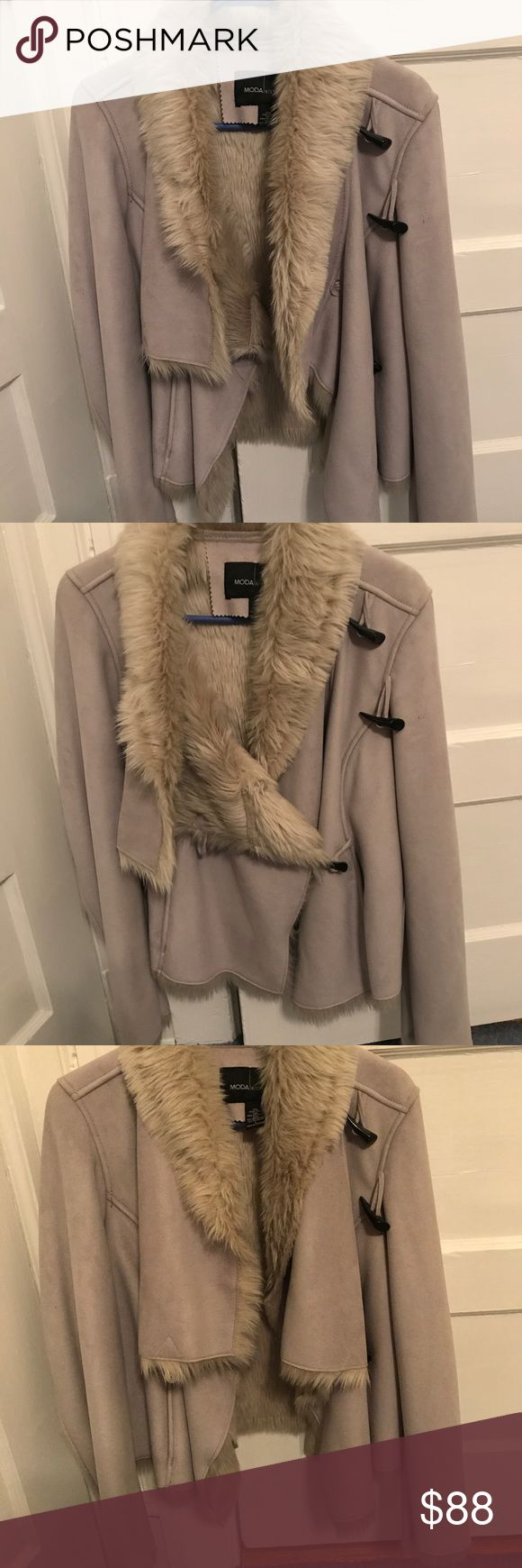 Gorgeous faux fur lined coat Brand new. Never worn. Inside is completely lined with faux fur.  Waist length depending on your height. Toggle closures in front. Drape detailed collar.  The color is a beige cream grey. Moda International Jackets & Coats