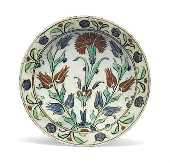 AN IZNIK POTTERY DISH | OTTOMAN TURKEY, CIRCA 1640 | Islamic Art Auction | dish, All other categories of objects | Christie's
