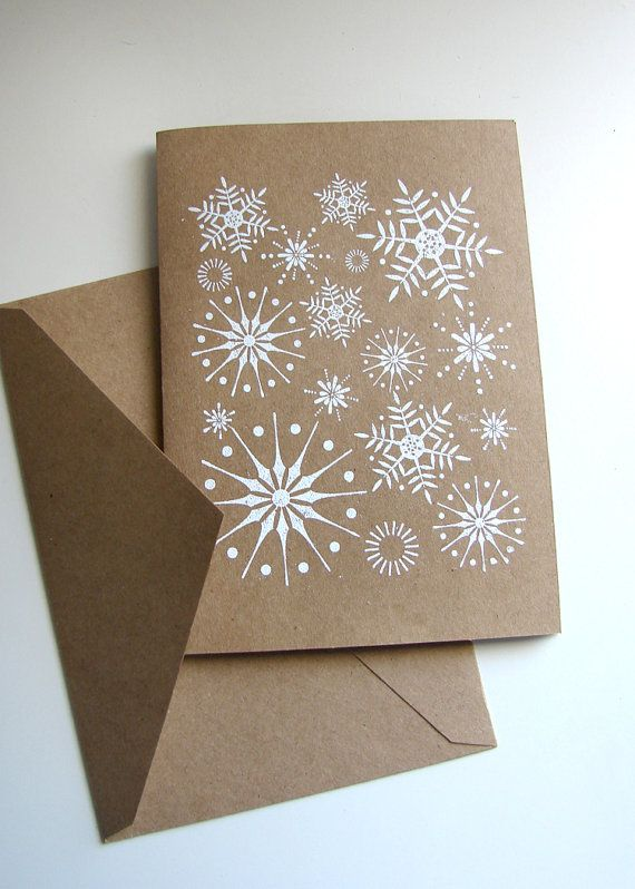 handmade Christmas/winter/snowflake card ... one layer ... kraft ... white stamped snowflakes fill the front .. like it!