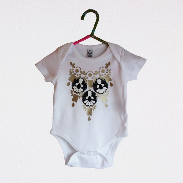 custom babygrow, embellished with a gold vinyl print, appliqué panels and soft vinyl jewels.  dakotaraedust