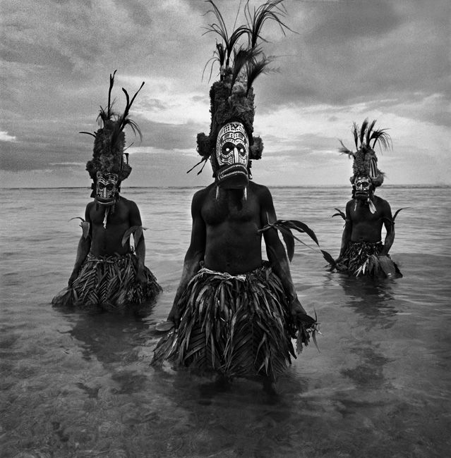 Malagan (a.k.a. Malanggan) ceremony, New Ireland, Papua New Guinea. The ceremony has its roots in funerary rites, but the ceremonies take several days and cover an enormous amount of social and political territory in the process. Malagan masks are now world-famous. Traditionally these were burnt at the conclusion of the event; in modern times most are now retained, as the carving tradition is now only known by a few.  Photo ©Chris Rainier