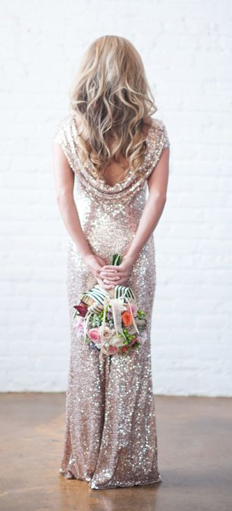 This is actually a wedding gown but I like the idea of my bridesmaids wearing it. The sequin reminds me of a sort of sparkly snow thing... if that makes any sense.
