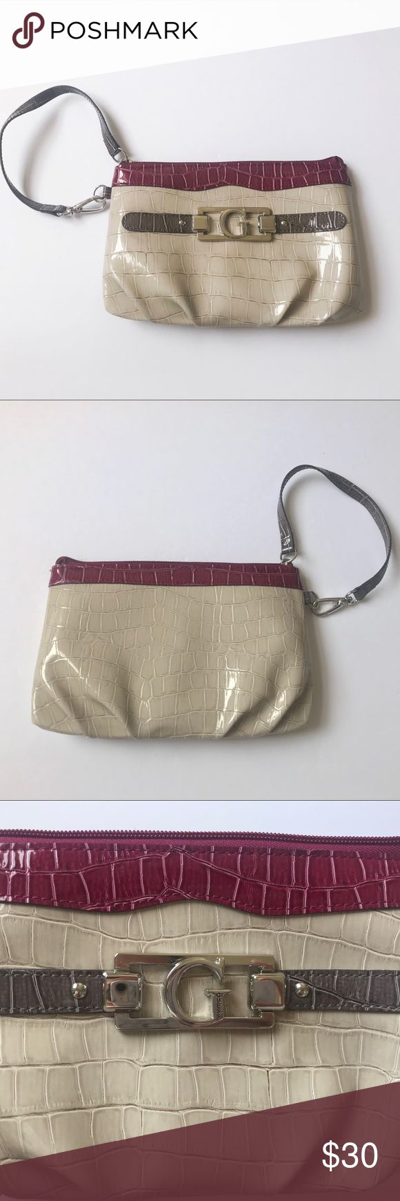 """Guess clutch Guess clutch gray and purple  Perfect condition outside  Has stains inside  Length 8,5"""" Height 6"""" Guess Bags Clutches & Wristlets"""