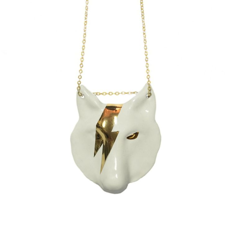 Pendant in white glazed ceramic face with a wolf. Details gloss 24 carat gold. Designed by Guille Hoz Garc�a and produced by the Ceramic Center Talavera.