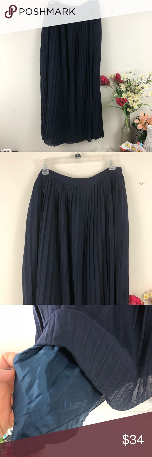 J. Crew Navy Pleated Fully Lined Maxi Skirt Deep navy maxi skirt from J. Crew. It features a thin waist band with a zipper and hook and eye closure on the back. The body of the skirt is Pleated all the way around and is fully lined underneath. Not sheer at all. It's in excellent condition with no flaws. The waist and length measurements are included in the last two images. (Location) {no trades - no modeling} J. Crew Skirts Maxi