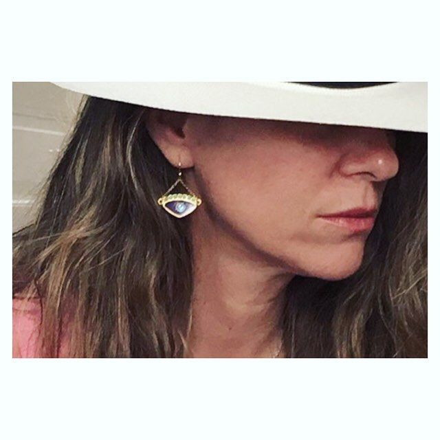 Anastasia is stylishly #wearingkaterinapsoma Our Tyche earrings in dark red and turquoise. #earrings #evileye #jewelry To shop link in our bio.