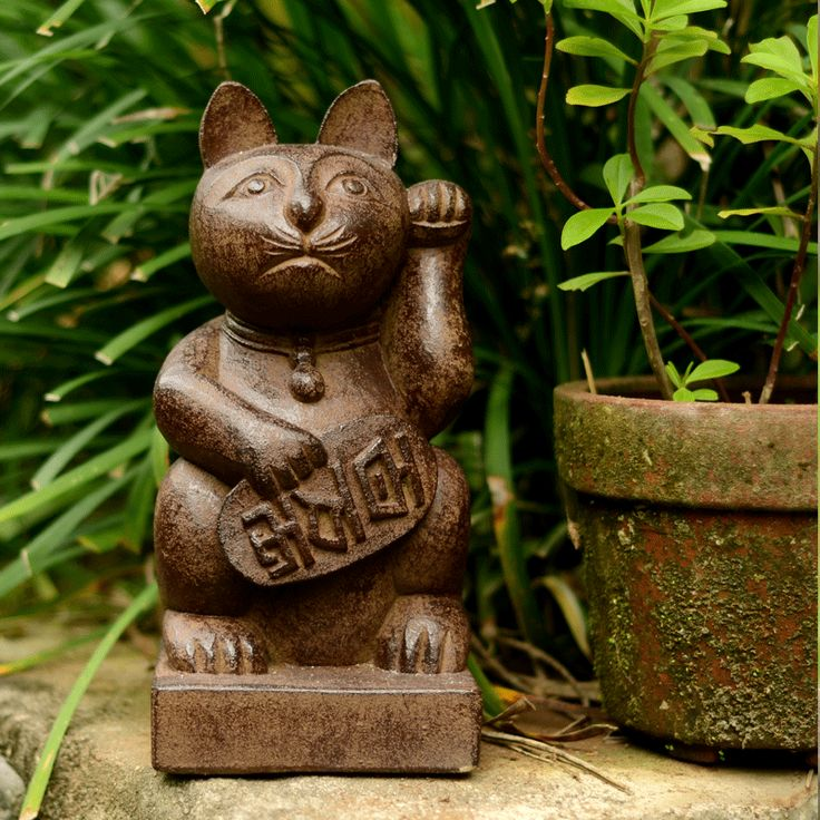 inspired living  - Volcanic Ash Japanese Maneki Neko (Lucky Cat) Statue, $48.00 (http://www.balilivingimports.com/volcanic-ash-japanese-maneki-neko-lucky-cat-statue-12-antique/)