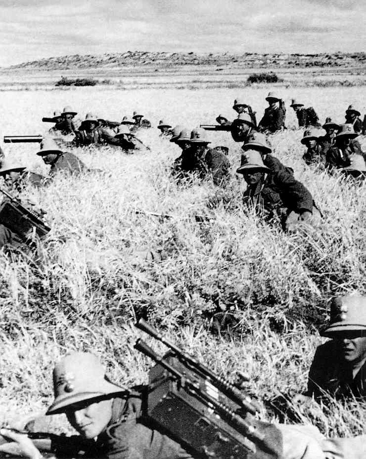 Italian troops advancing on Addis Ababa, the Ethiopian capital - 1936.  Garibaldi.  Notice that they still pack WW I machine guns.