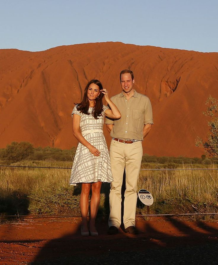Catherine Duchess of Cambridge and Prince William Duke of Cambridge pose in front of Ayers Rock in Australia