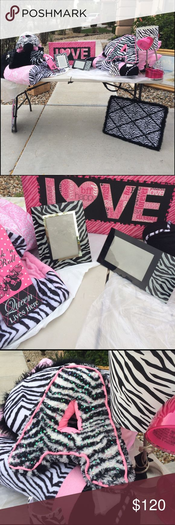 Pink and zebra bedroom set💕 A beautiful pink and zebra bedroom set. It comes with a full pink and zebra bedding with. Zebra lamp and a pink desk lamp. It comes with a love sign and two zebra picture boards. With many pillows including two zebra blankets and a zebra and pink pillow pet. A pink and zebra door handle sign. Two zebra glitter picture frames. And a small night light lamp shade. Other